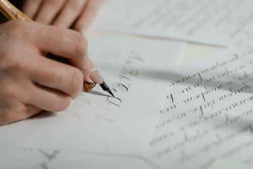 Gratis arkivbilde med blekk, hånd, håndskrift