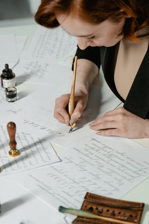A Woman Writing on a Paper