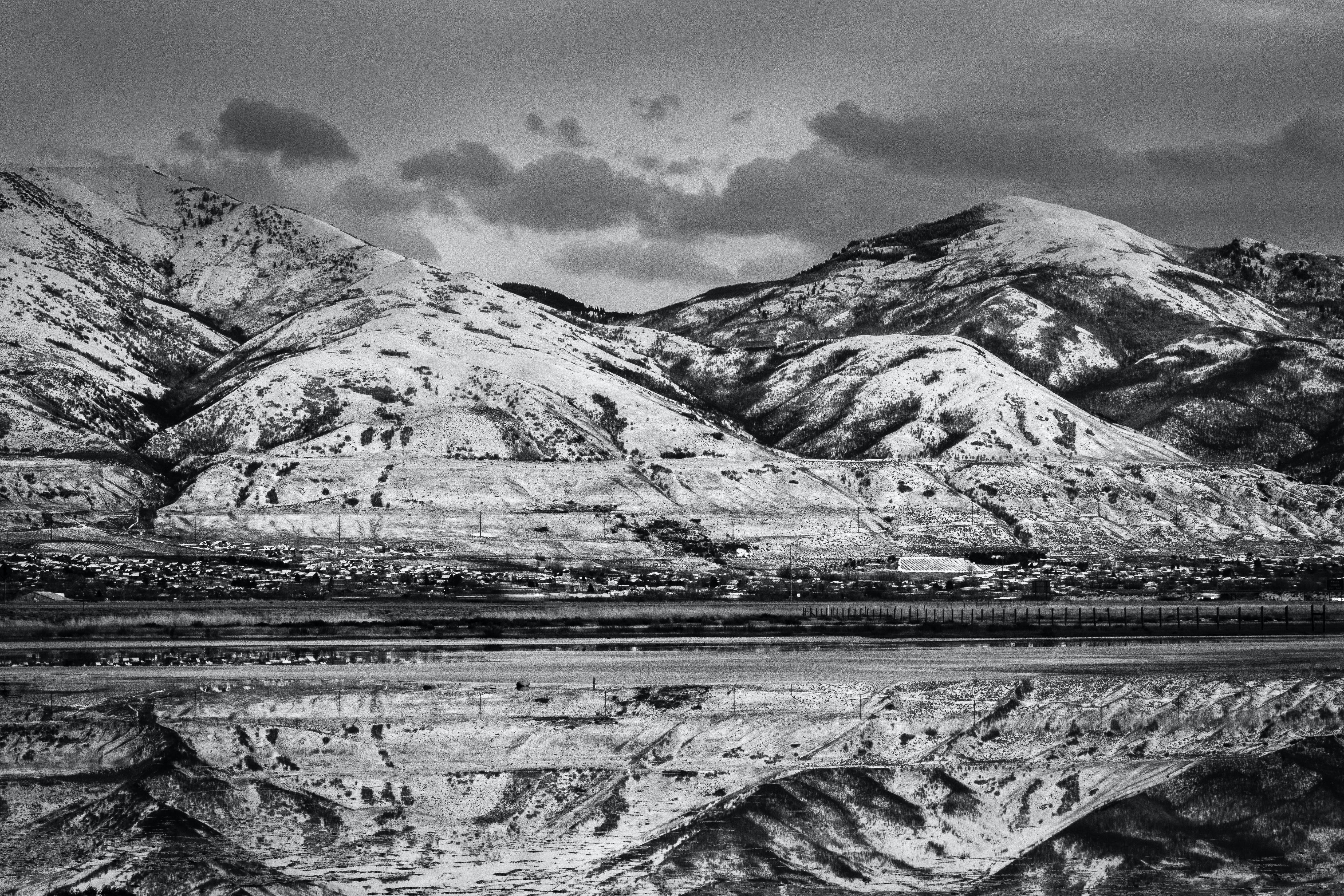 Grayscale Photo of a Landscape View of Mountains