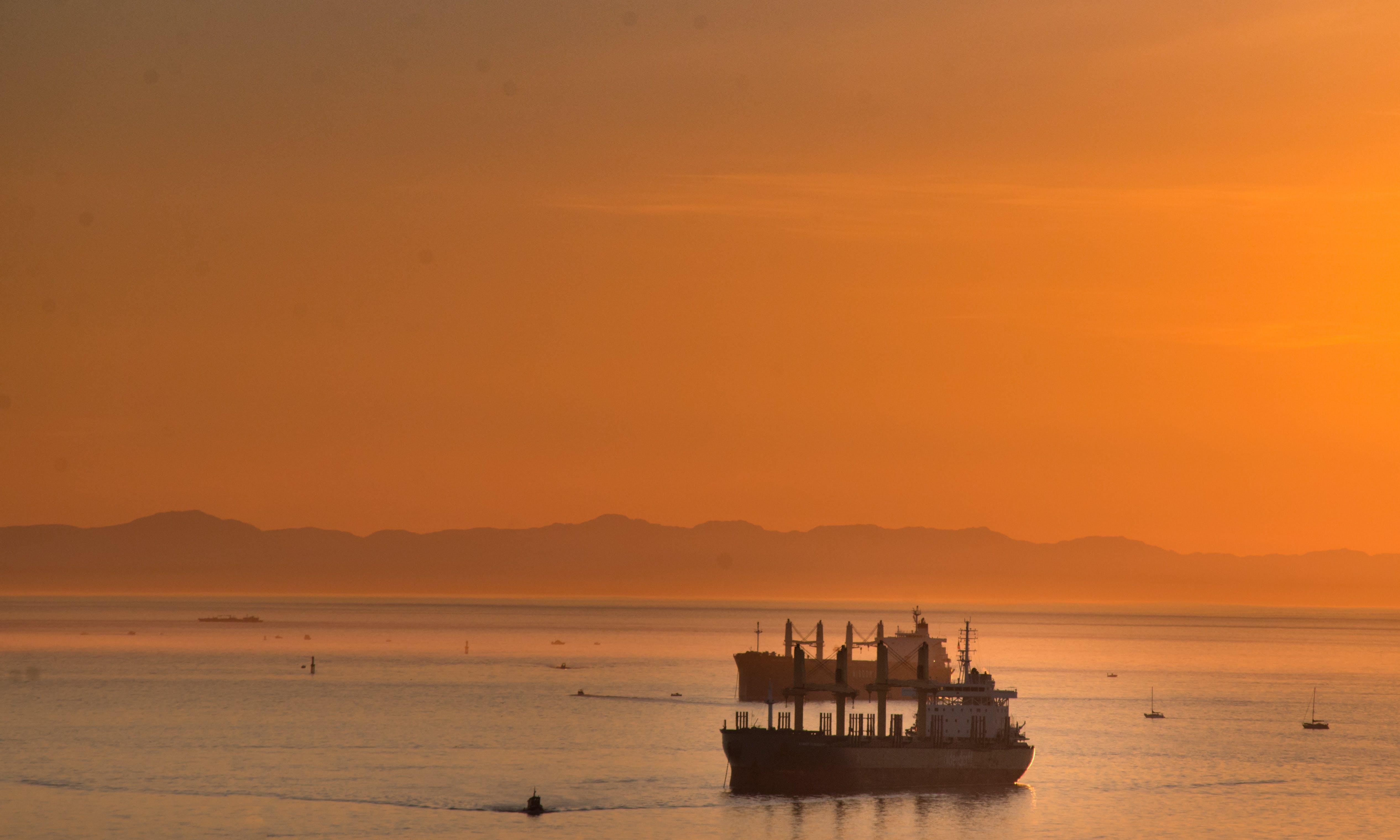 Free stock photo of freighter, ocean, orange sky, sunset