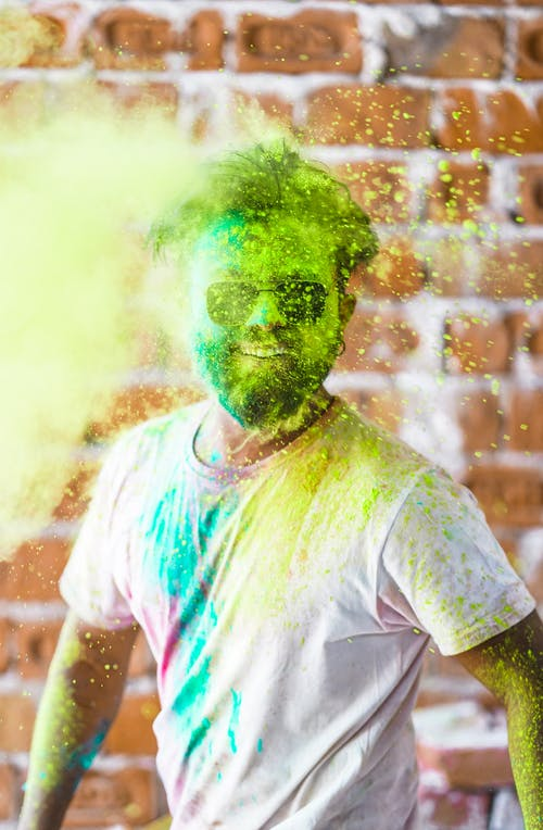 Man in White Crew Neck T-shirt With Green Powder on His Face