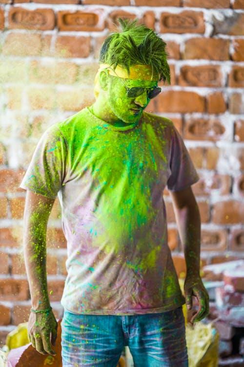 Man in Green Crew Neck T-shirt Wearing Green Mask