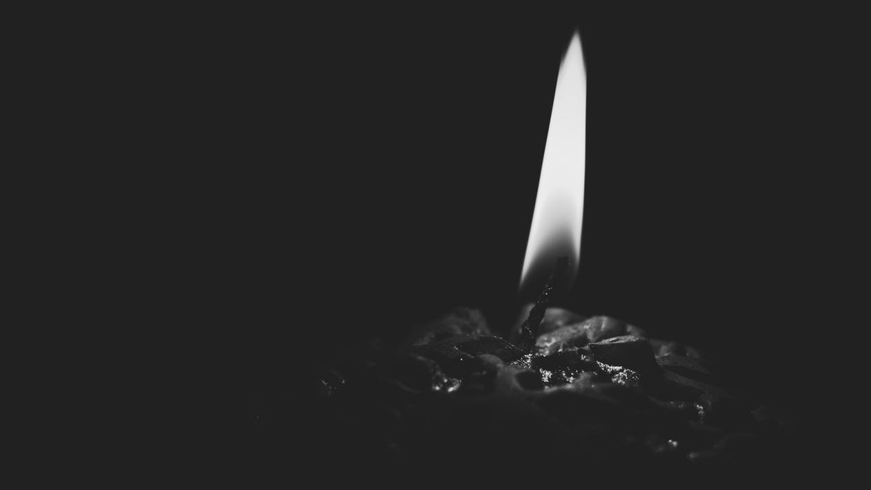 Lighted Candle Gray Scale Photo