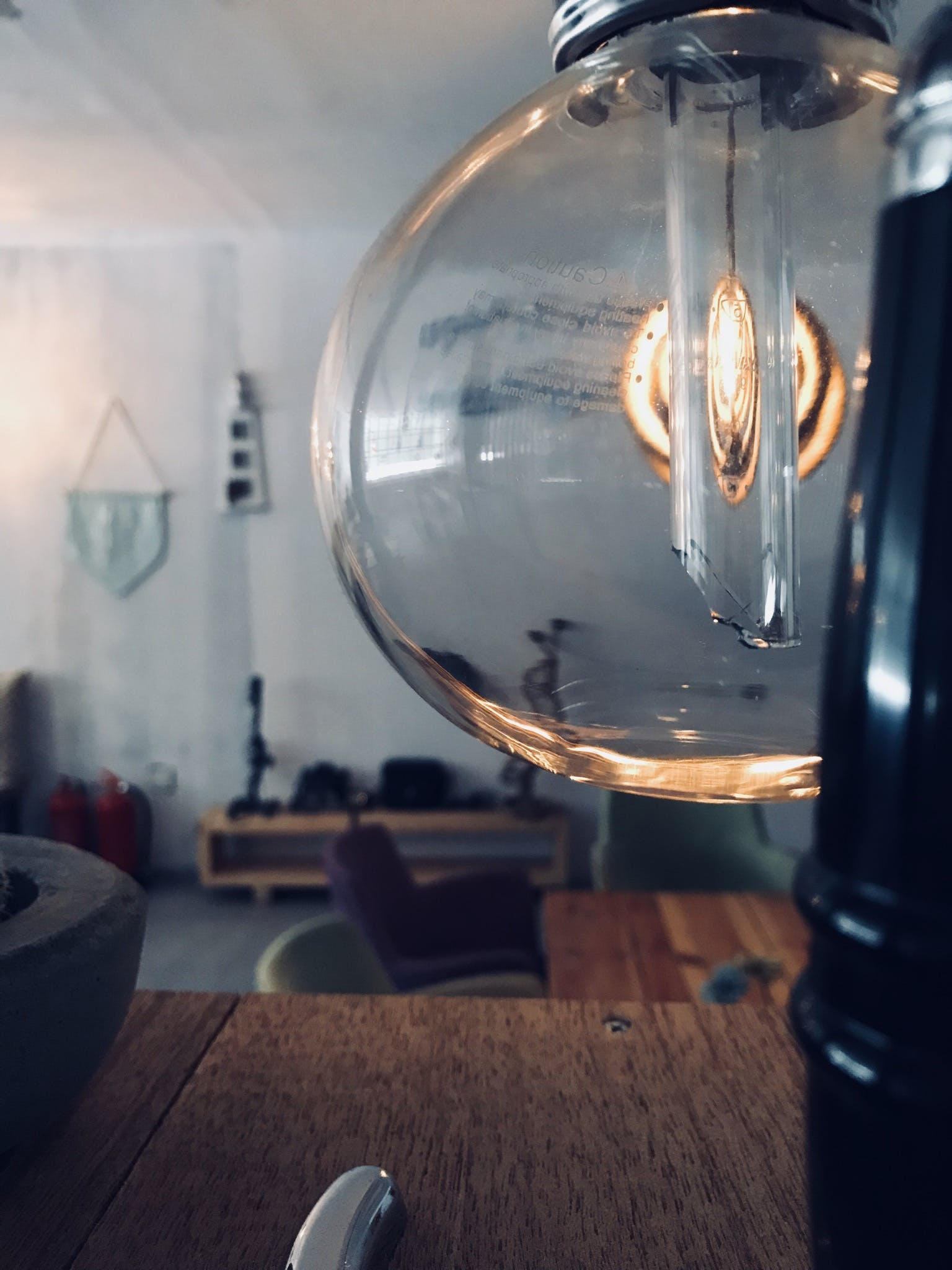 Clear Glass Lamp Near Brown Wooden Surface