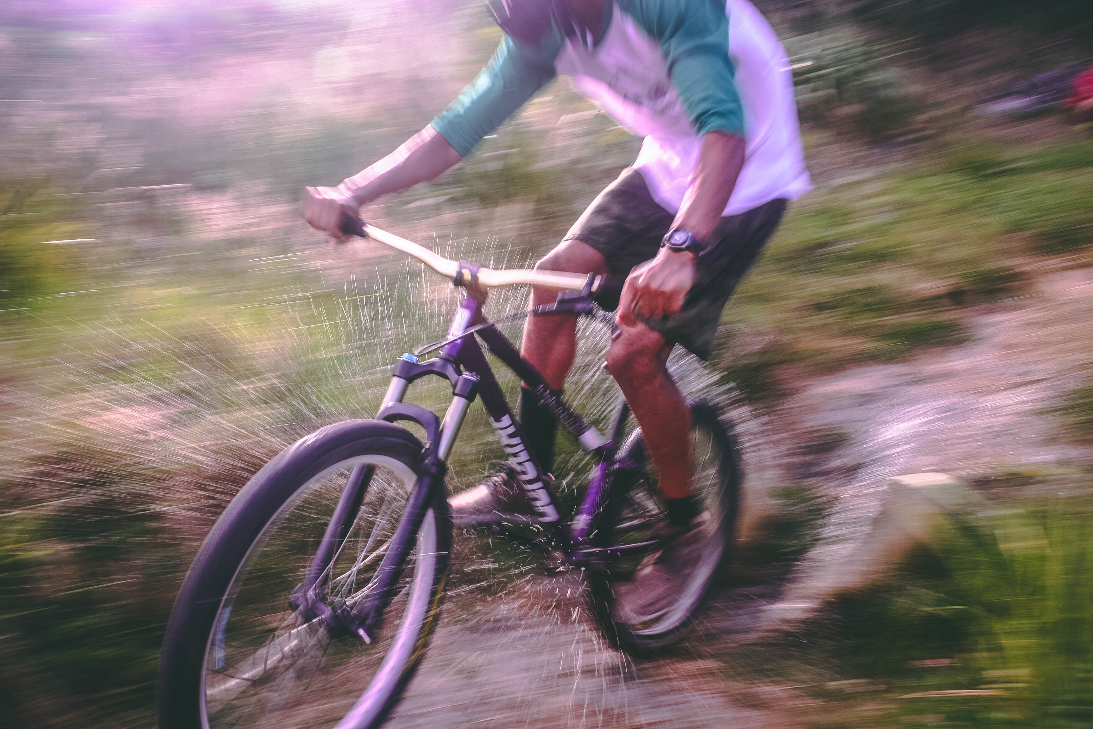 Man Riding Black and White Hardtail Mountain Bike