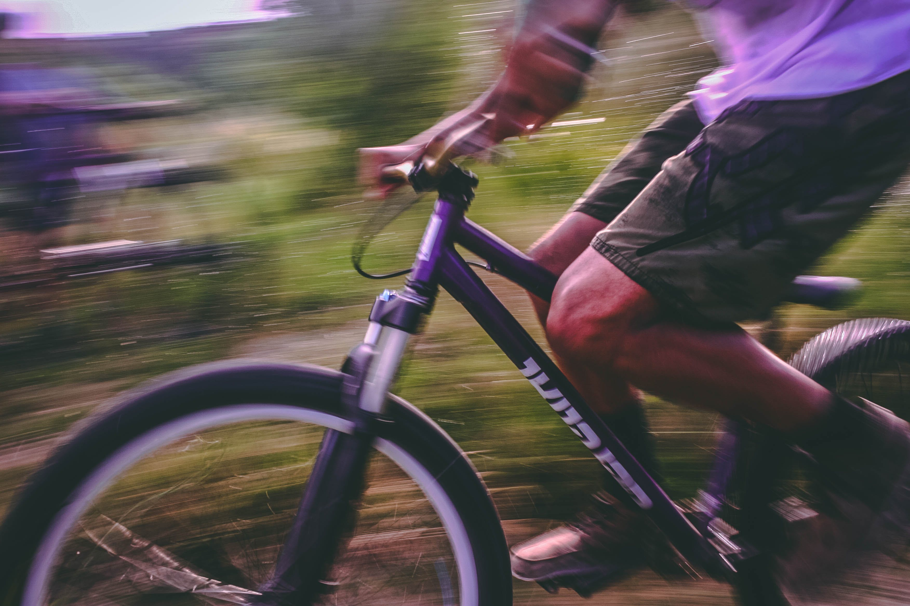 Time Lapse Photo Of Man Riding On Bicycle