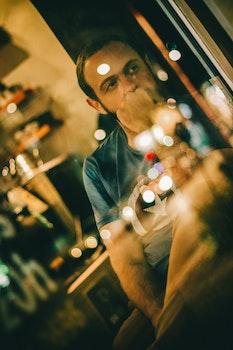 Free stock photo of man, window, reflection, reflections