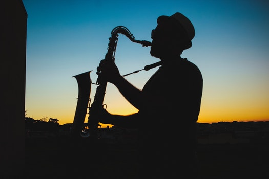 Silhouette of a Man Playing Saxophone during Sunset