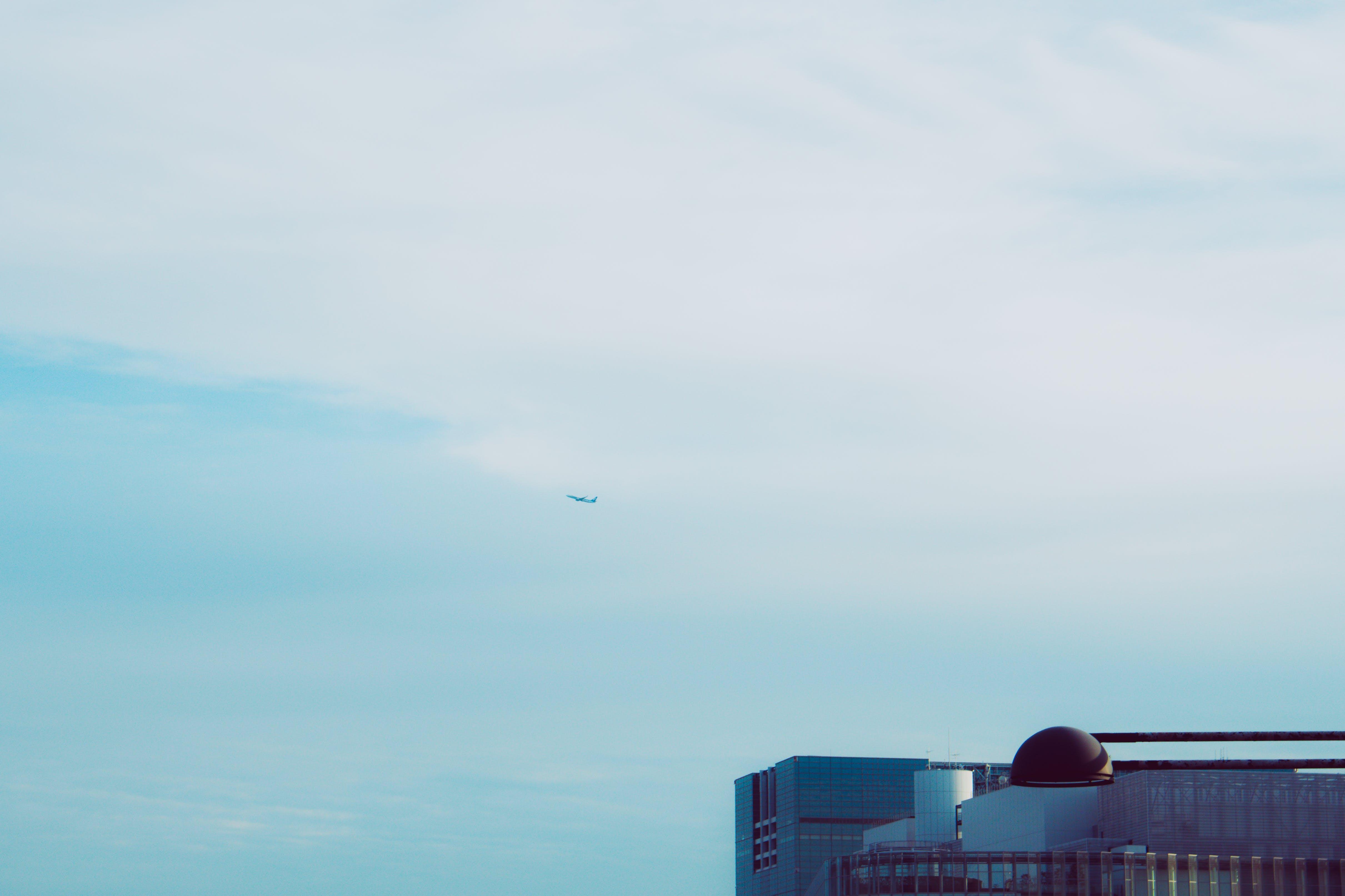 Plane Flying on Blue Sky