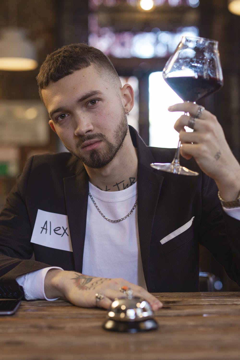 Man holding a wine glass.   Photo: Pexels