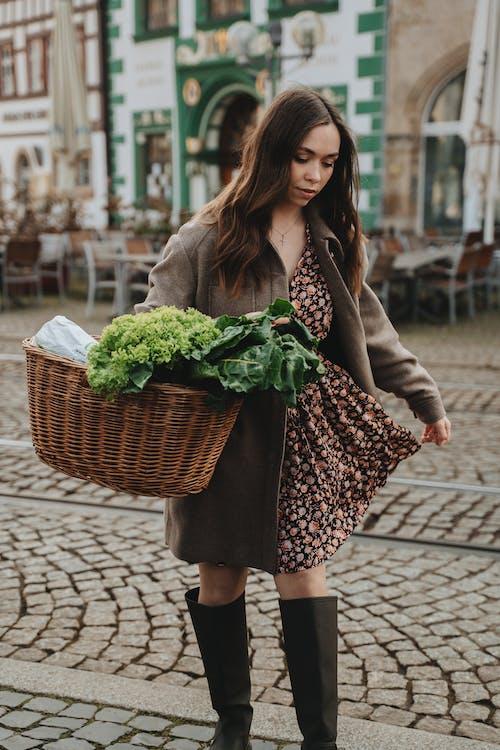 Woman Carrying Wicker Basket Full of Fresh Vegetables