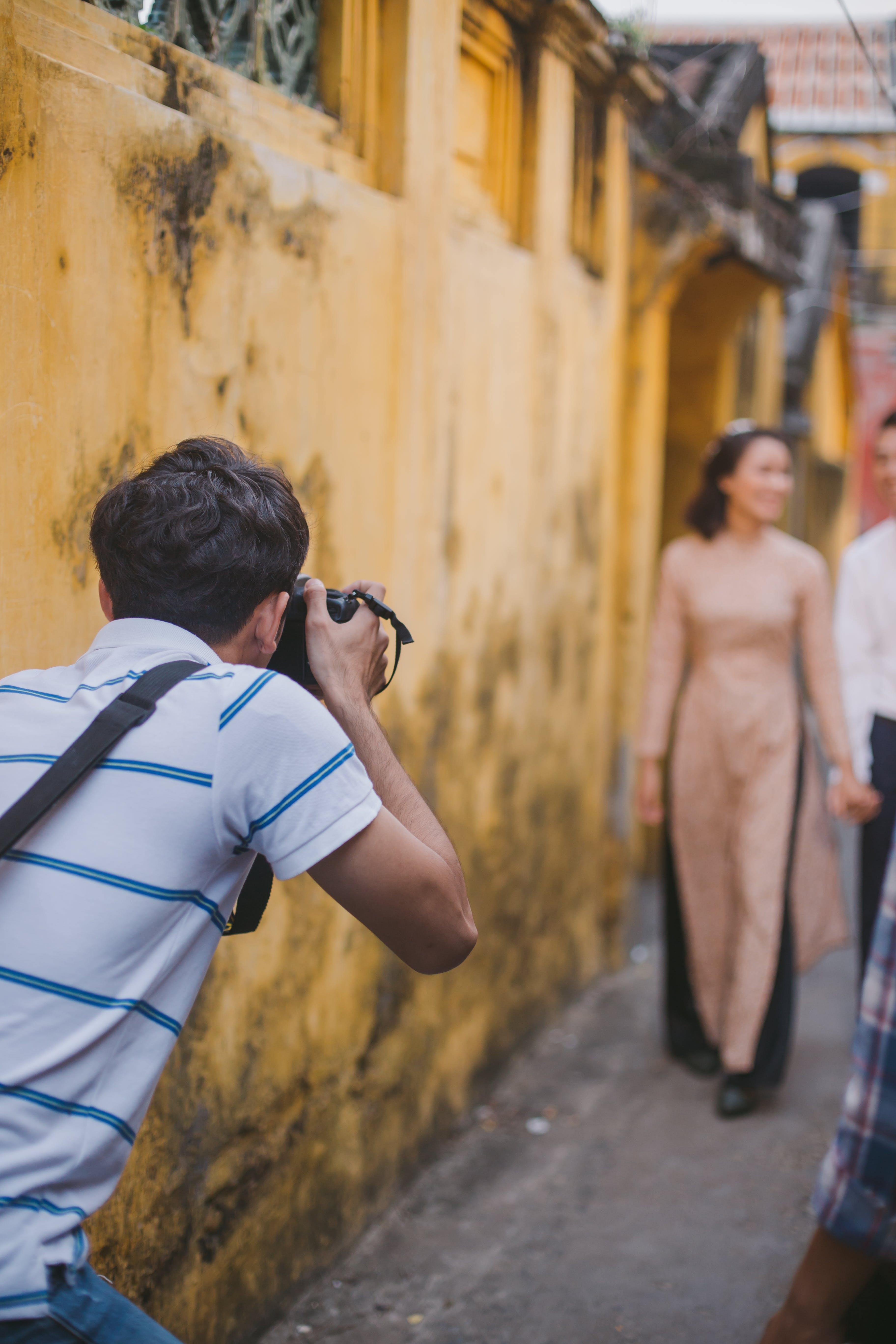Man Holding Camera Outdoor