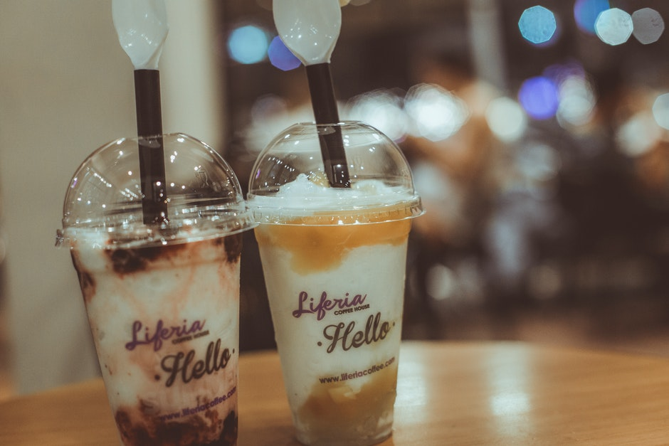 Two Liferia Hello Coffee Drinks on Brown Wooden Table
