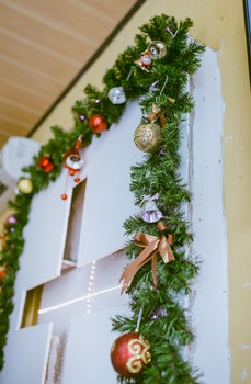 Photo of Green Garland With Bold Bauble Decor