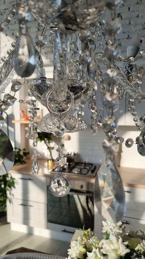 Stylish cut glass chandelier in kitchen