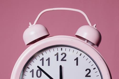 Close-Up Photo of Pink Alarm Clock