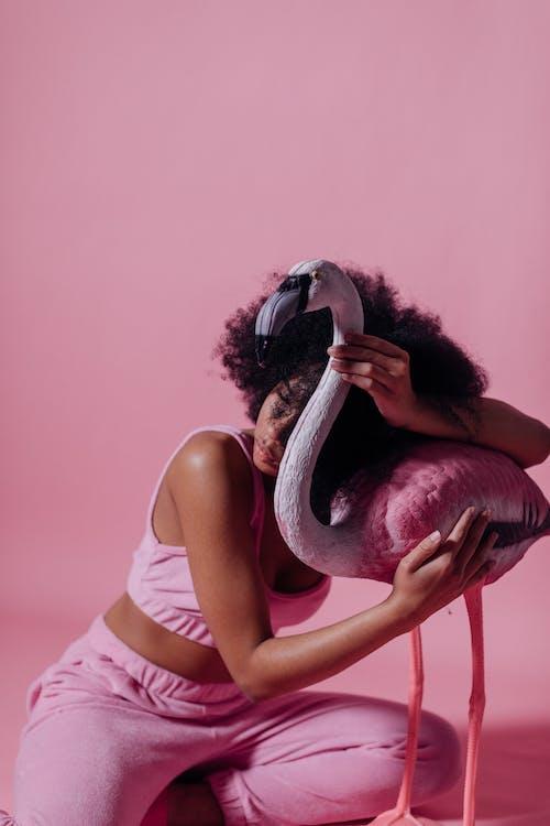 Woman Hugging a Pink Flamingo
