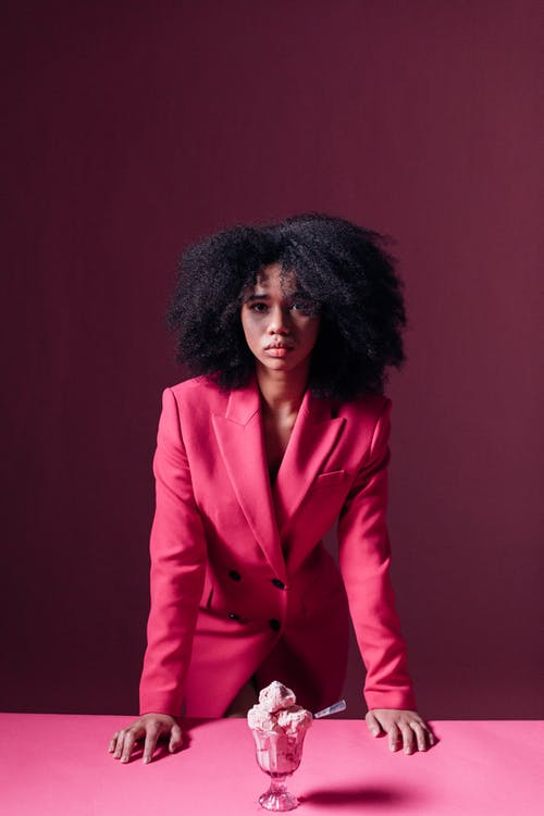 Woman in Pink Suit Looking at the Camera