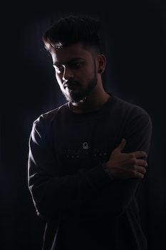 Photography of Man in Black Sweatshirt