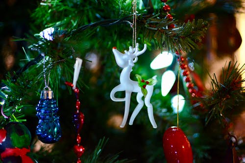 Shallow Focus Photography of White Deer Christmas Tree Ornament