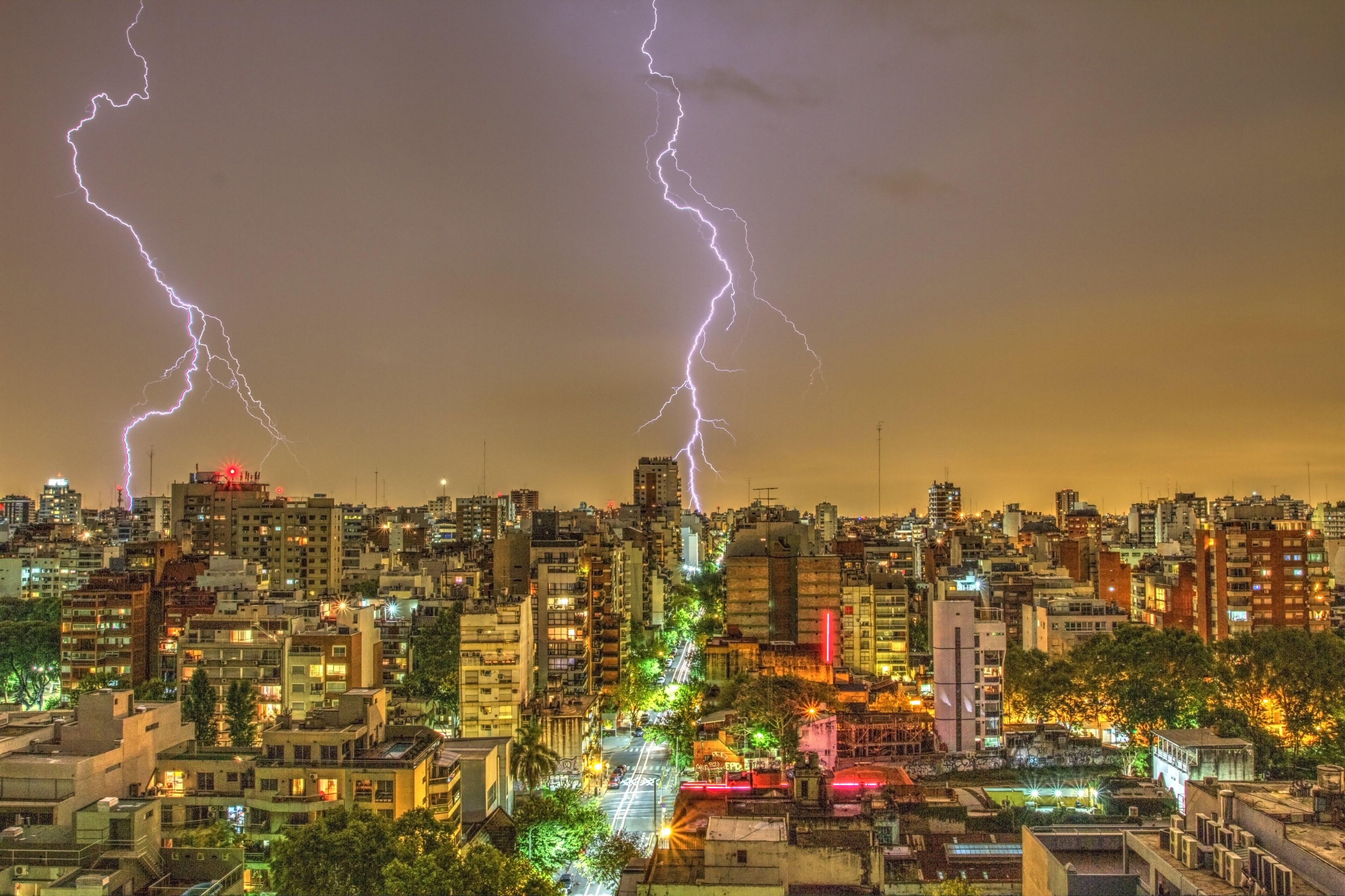 Photography of Thunder Strike Behind City