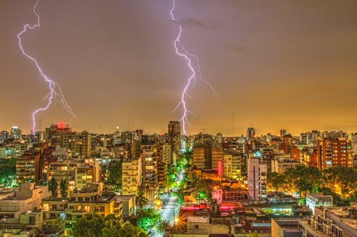 Photography of Thunder Strike Behind City