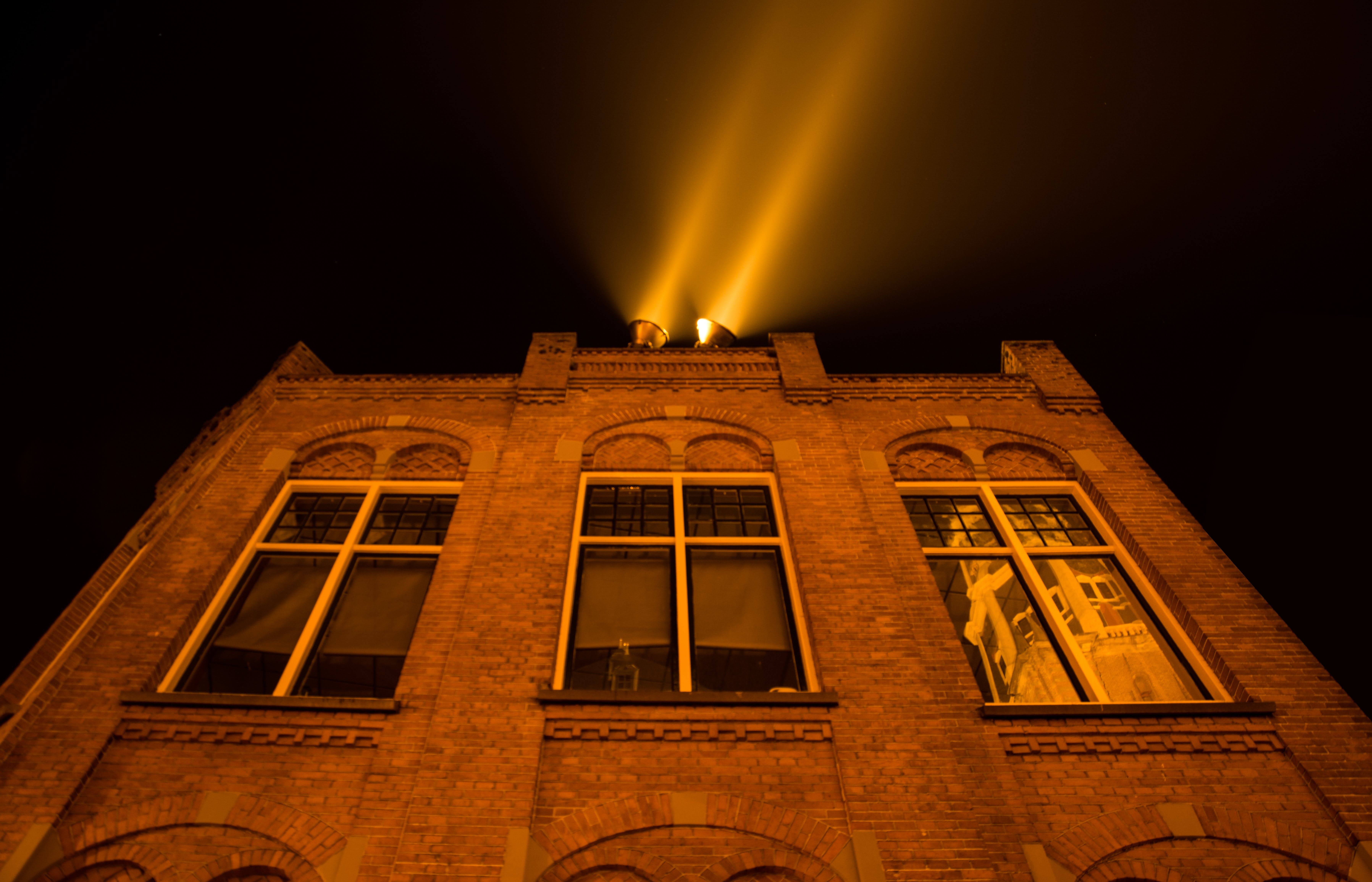 Bricked Building White Light on Rooftop