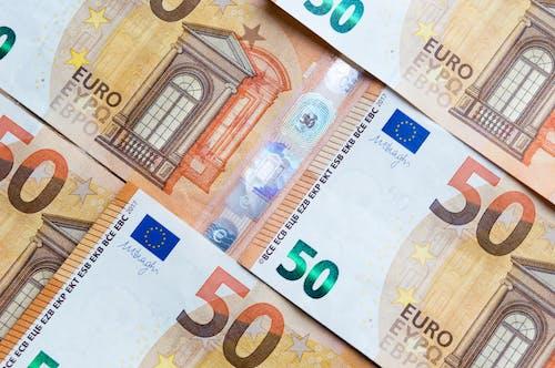 50 Euro Bill on White and Blue Polka Dot Textile