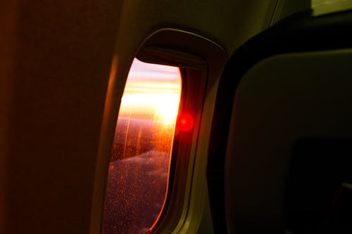Photography of Airplane Window During Dusk