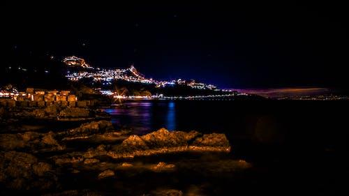 açık hava, akşam, aydınlatılmış, deniz içeren Ücretsiz stok fotoğraf