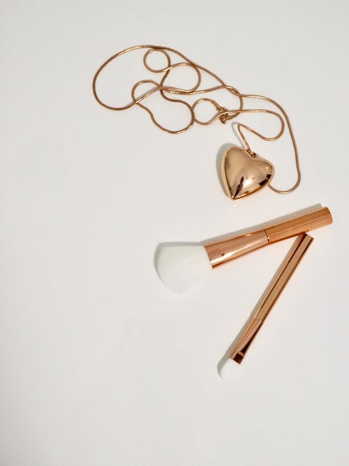Photo of Gold Make-up Brushes and Necklace