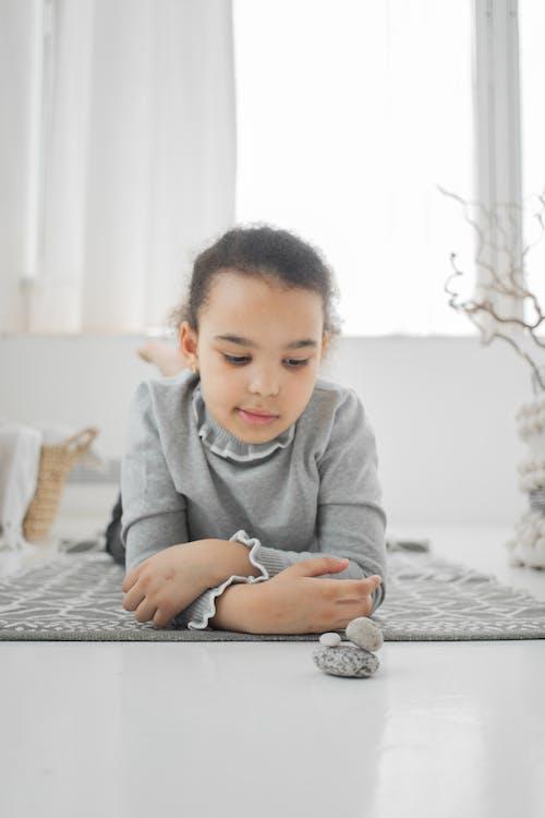 Girl in Gray Sweater Using Black Smartphone