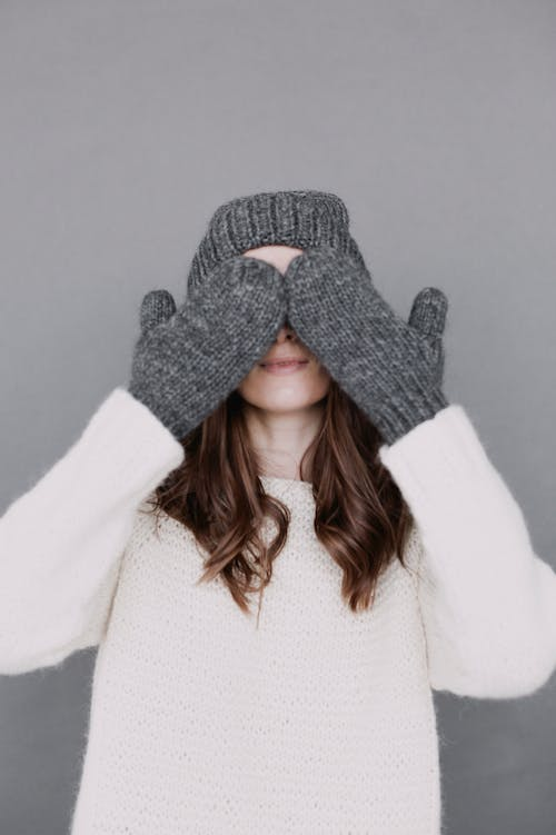 Woman Covering Her Eyes With Her Hands