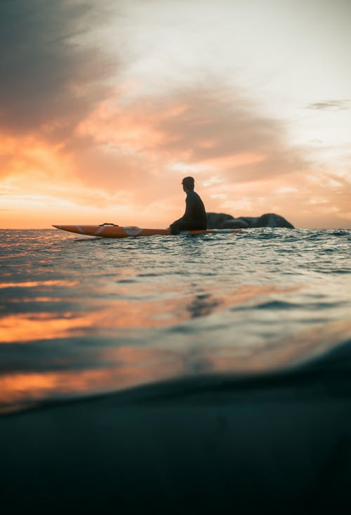 Man in Water during Sunset