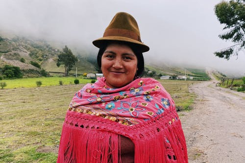 Woman in Brown Hat and Red and Blue Scarf