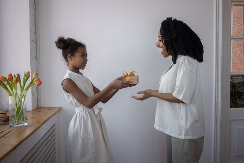 A Girl Giving Her Mother a Present for Mother's Day