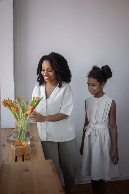 A Mother Arranging Tulips in a Flower Vase