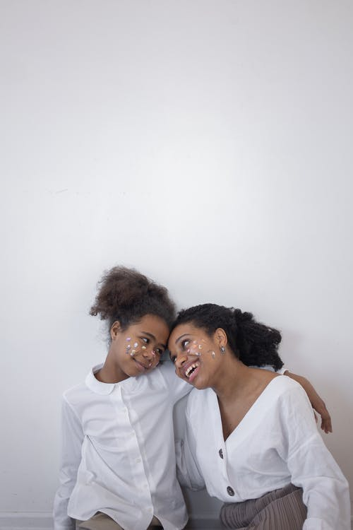 A Mother and Daughter Smiling at Each Other