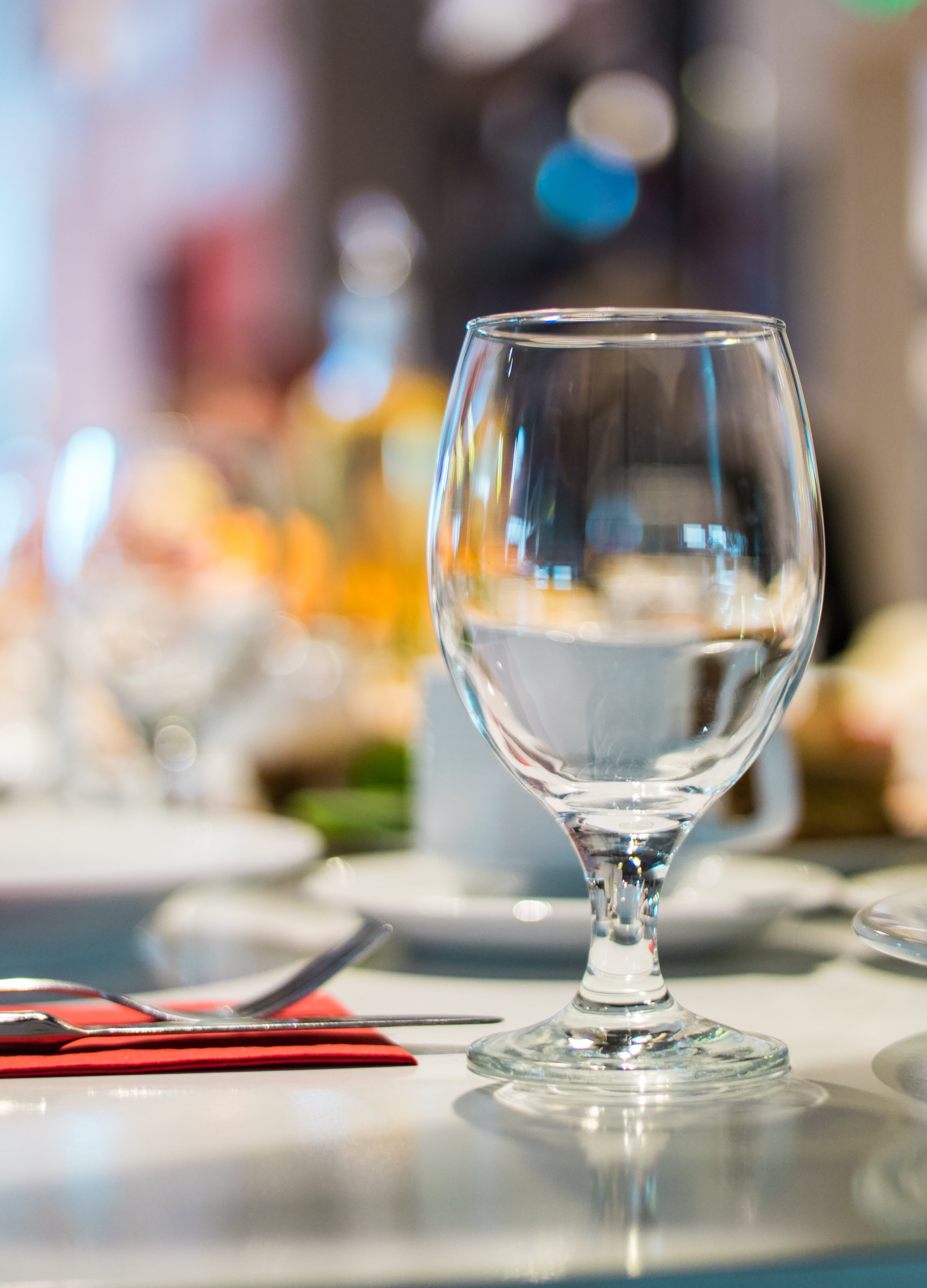 Selective Focus Photography of Clear Wine Glass