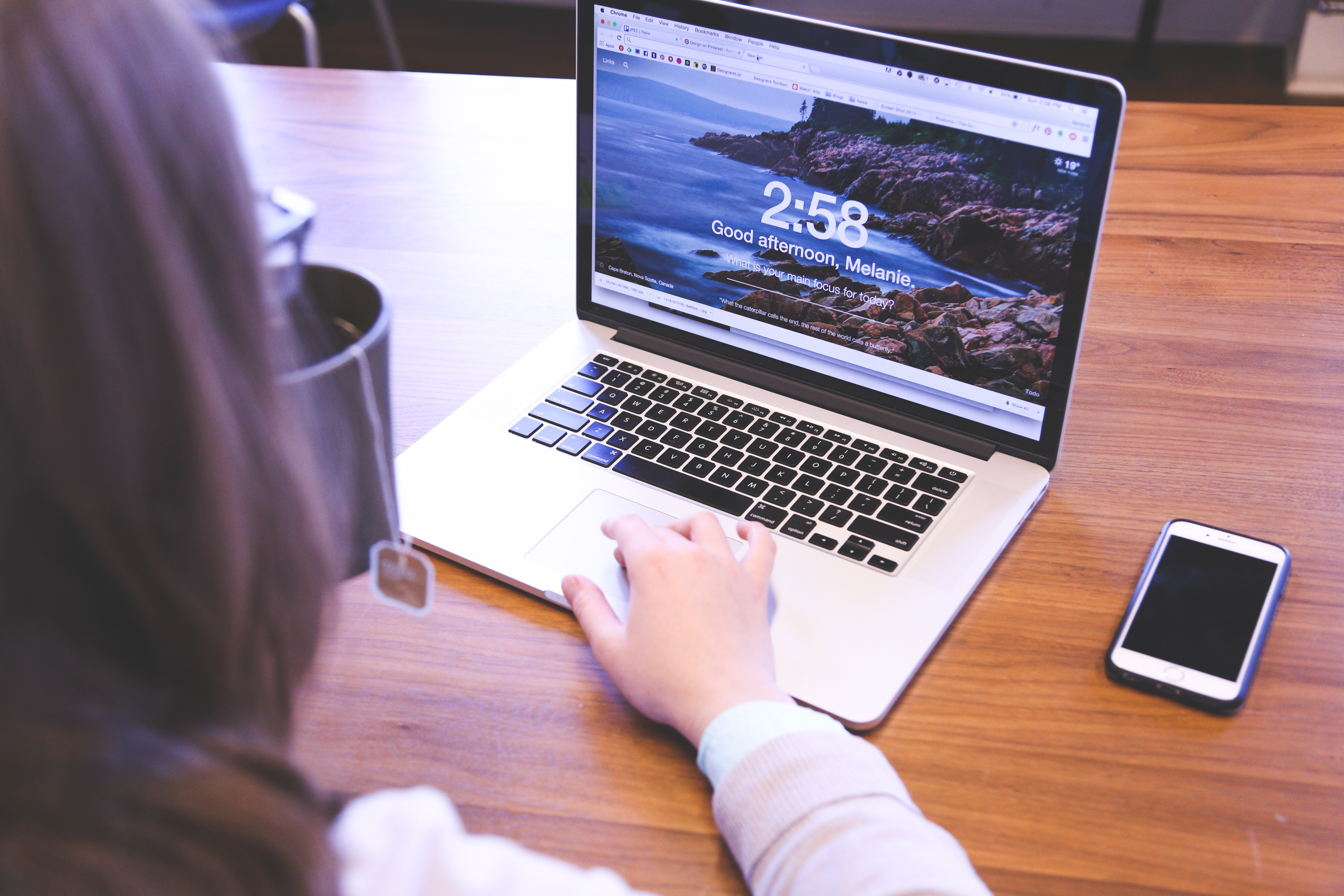 Woman Using Macbook Pro on Table