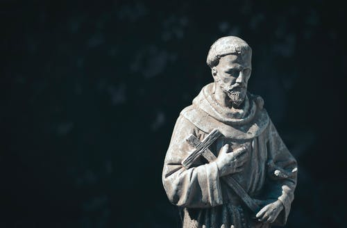 A Concrete Statue of a Monk
