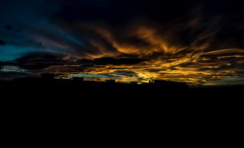 Безкоштовне стокове фото на тему «безтурботний, будівлі, Захід сонця, золота година»