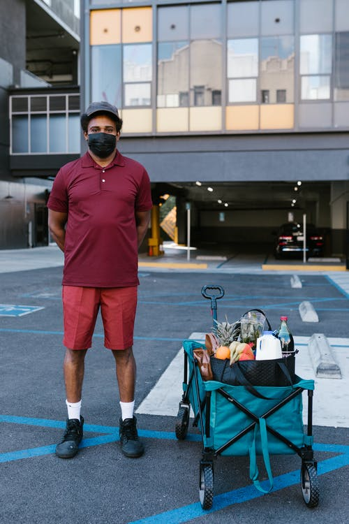 A Deliveryman in a Parking Lot