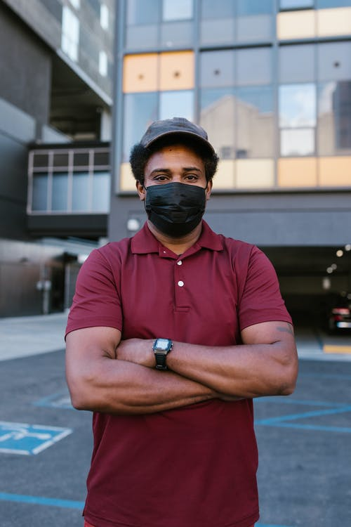 A Man in Maroon Shirt Wearing a Face Mask