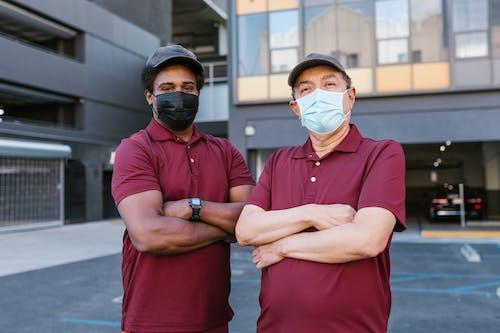 Men in Maroon Shirts Wearing Face Masks