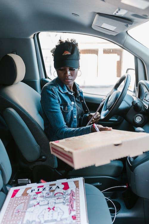 A Pizza Deliverywoman Wearing a Denim Jacket