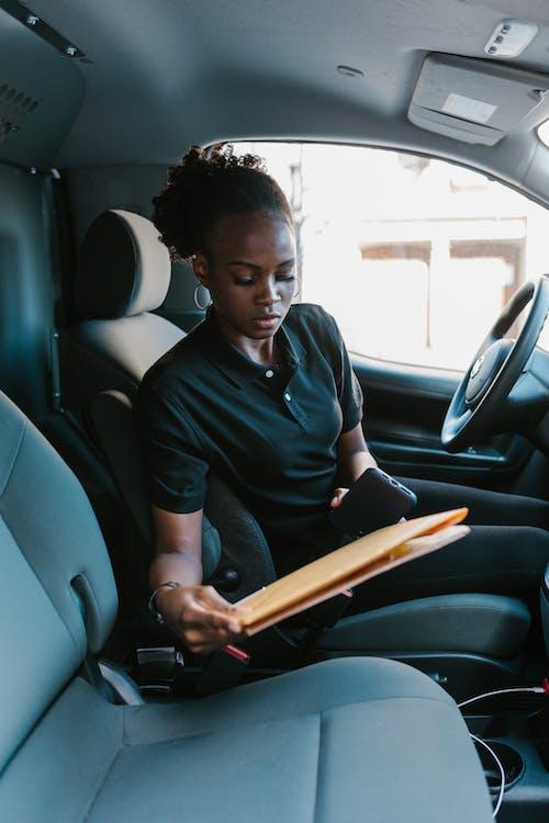 Man in Black Polo Shirt Sitting on Car Seat