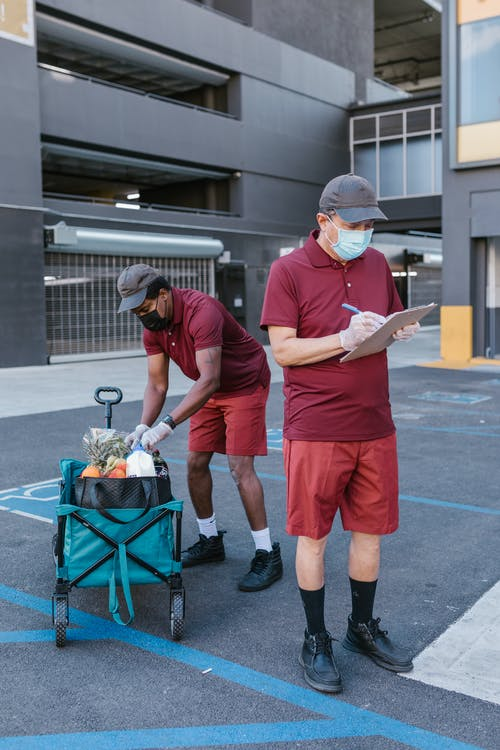 Deliverymen Checking Their Delivery Checklist