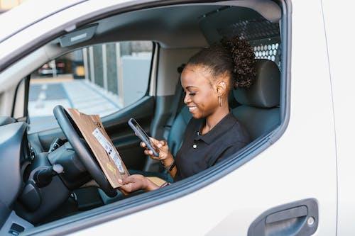 Woman in Black Shirt Sitting on Car Seat