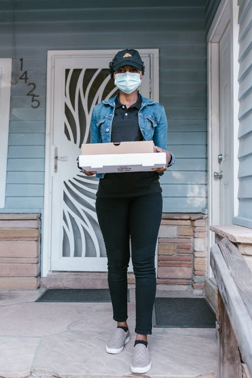 A Deliverywoman Holding Pizza Boxes